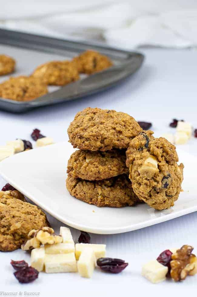 Cranberry Pecan White Chocolate Oatmeal Cookies stacked on plate
