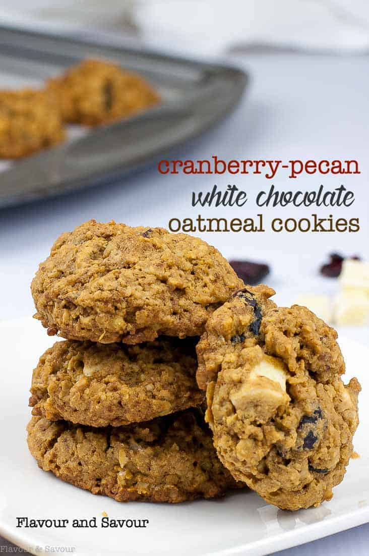 These Cranberry Pecan White Chocolate Oatmeal Cookies feature crunchy pecans, sweet cranberries and creamy white chocolate. They're gluten-free and made with rolled oats and coconut sugar. #glutenfree #whitechocolate #cranberries #pecans #oatmeal