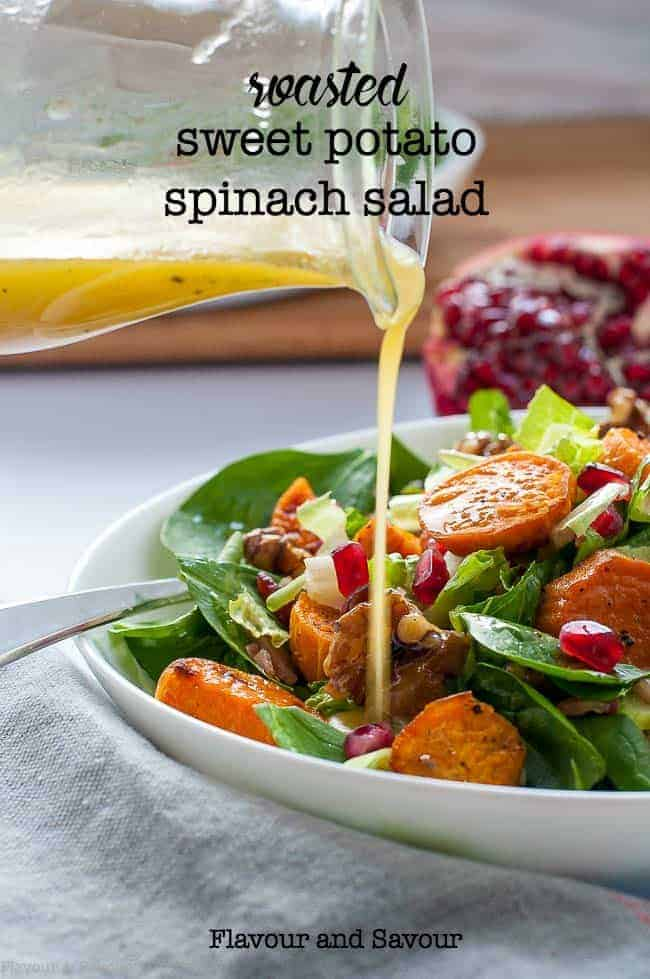 This Roasted Sweet Potato Spinach Salad with Maple-Glazed Walnuts, Pomegranate and Bacon makes a nutritious lunch or a festive salad for a holiday dinner. Drizzle with Honey-Dijon Dressing. #wintersalad #sweetpotato #Christmas #fallsalad #spinach