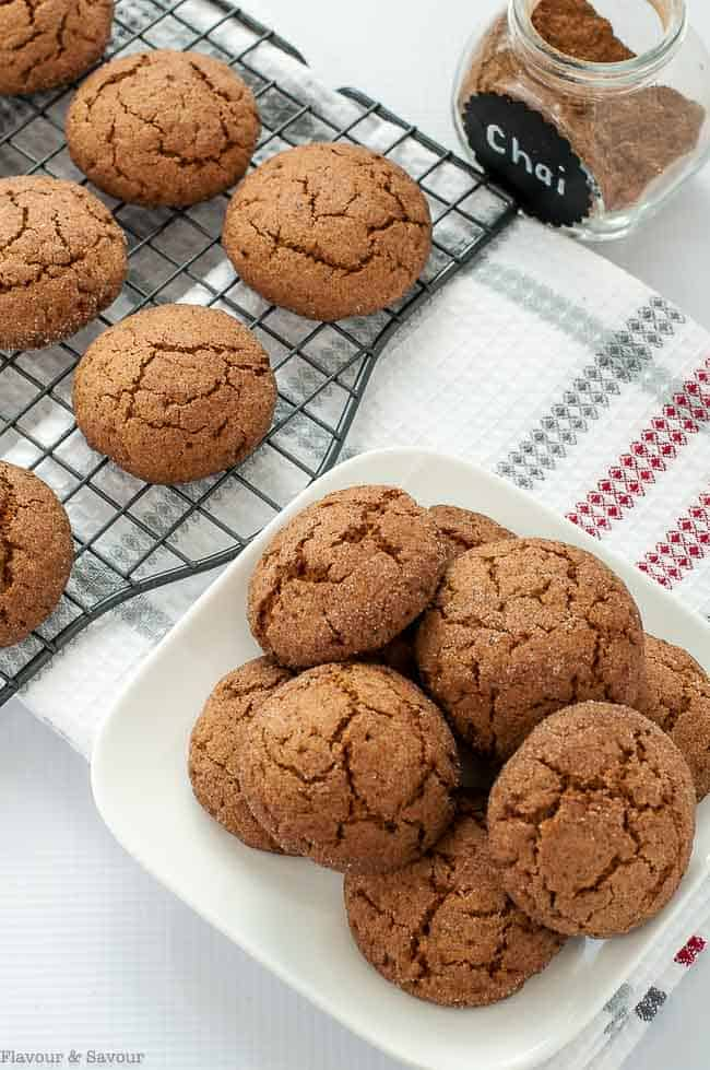 Gluten-Free Chai Spiced Snickerdoodles on a cooling rack and stacked on a plate
