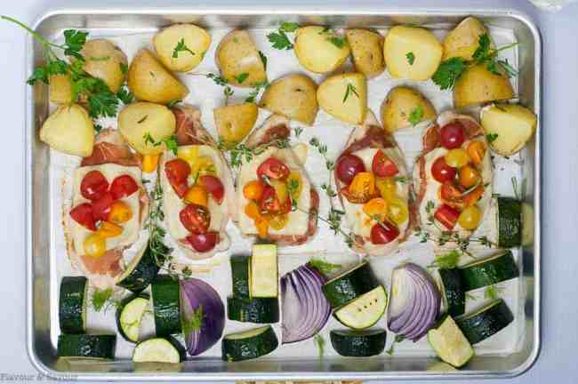 Horizontal overhead view of baked Prosciutto and Cheesy Chicken Sheet Pan Dinner