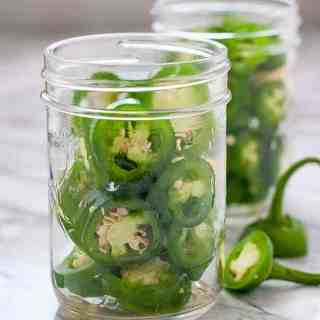 Jalapeño Pepper rings in Mason Jars ready to make Quick Refrigerator Pickled Jalapeños