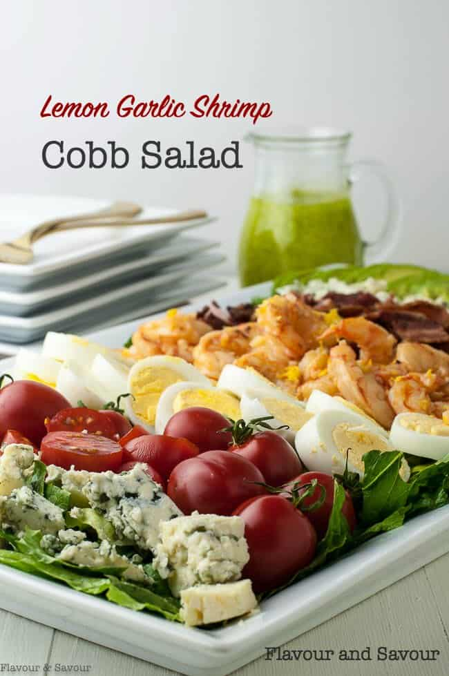 My twist on a traditional Cobb Salad recipe!  It combines lemon garlic shrimp, bacon, hard-boiled eggs, cherry tomatoes, blue cheese and avocado on a bed of romaine and drizzled with Creamy Avocado Dressing. #shrimp #cobb #salad #bacon #bluecheese #eggs #avocado #tomatoes #avocado_dressing #howtopeelhardboiledeggs #flavourandsavour