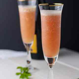 Two flutes of Rhubarb Bellini Prosecco Cocktail