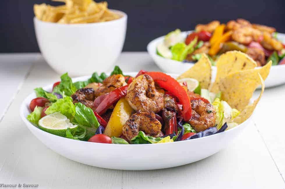 Shrimp Fajita Salad with Honey Lime Vinaigrette with a bowl of tortilla chips