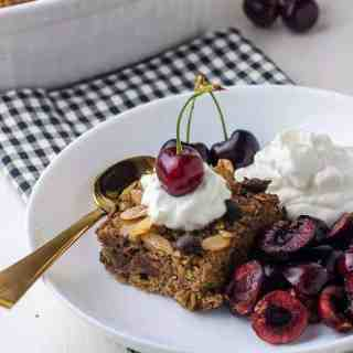 Chocolate Espresso Baked Oatmeal with yogurt and cherries in a bowl