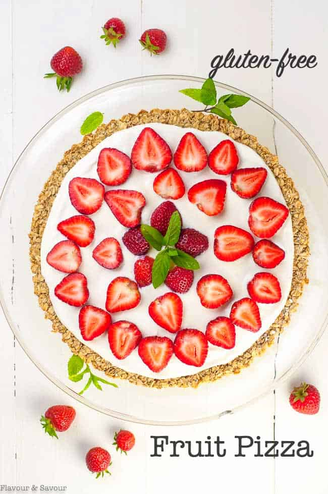 This healthy Breakfast Fruit Pizza is gluten-free and refined sugar-free. It's made with an oatmeal and honey crust and topped with yogurt and fresh berries. Fun for kids to make. A cheerful way to start the day! #fruitpizza #glutenfree #oatmealcrust #yogurt #breakfastpizza