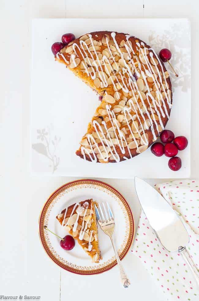 Flourless Cherry Almond Ricotta Cake overhead view of a cake and a slice
