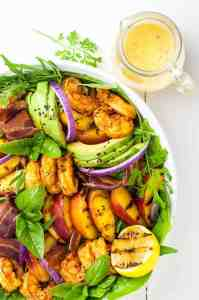 Grilled Peach Avocado Chipotle Shrimp Salad with dressing