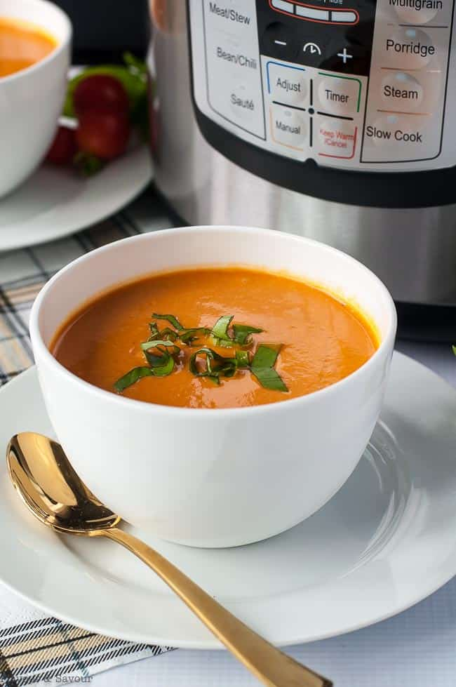Instant Pot Creamy Tomato Soup garnished with basil