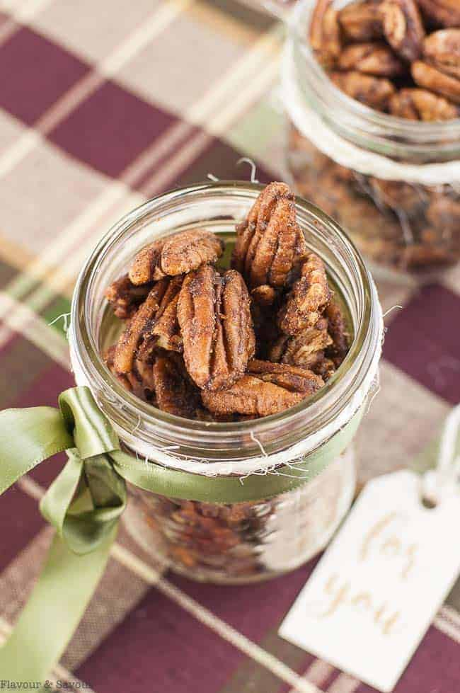 Close up view of a Mason jar gift of Low-Carb Roasted Pumpkin Spice Pecans
