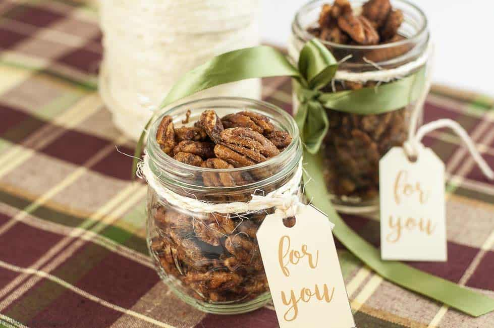 Two jar of Low-Carb Roasted Pumpkin Spice Pecans with attached gift tags