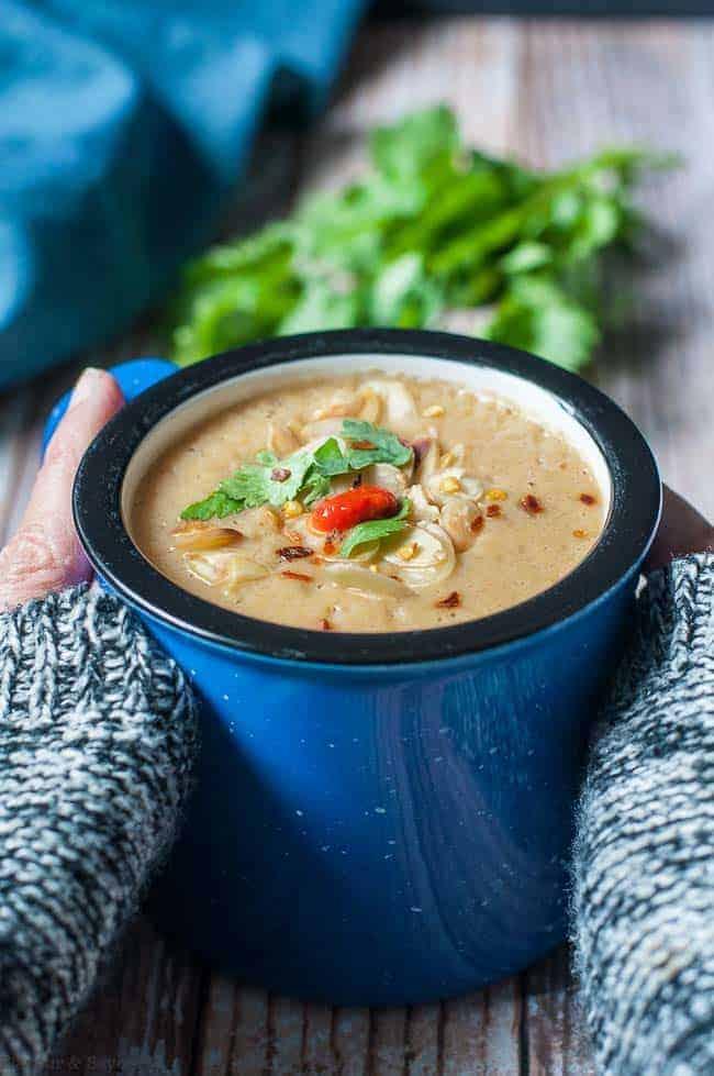 Holding a warm mug of Slow Cooke Moroccan Harissa Cauliflower Soup