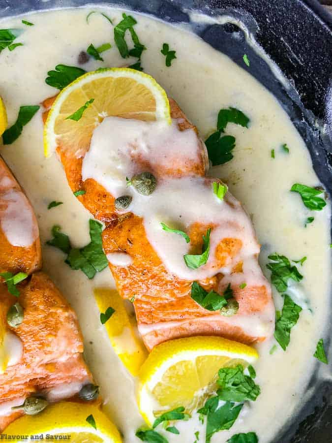 30 Minute Creamy Lemon Salmon Piccata closue up view in cast iron skillet