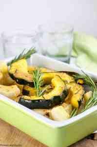 Serving dish full of Garlic Parmesan-Crusted Roasted Acorn Squash