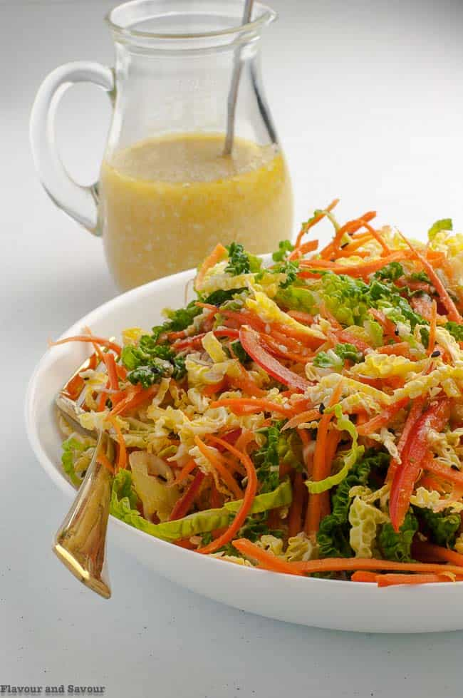 Pouring Dressing on Crunchy Cabbage Coleslaw with Sesame Miso Dressing