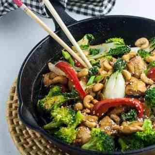 Japanese Chicken Stir Fry in Cast iron fry pan with chopsticks