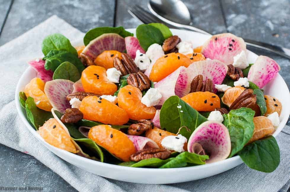 Watermelon Radish and Satsuma Spinach Salad in a serving bowl