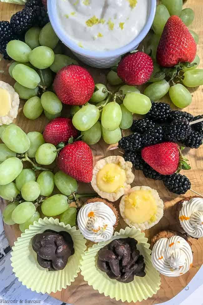 Dessert Fruit Platter with mini desserts, grapes, strawberries and blackberries