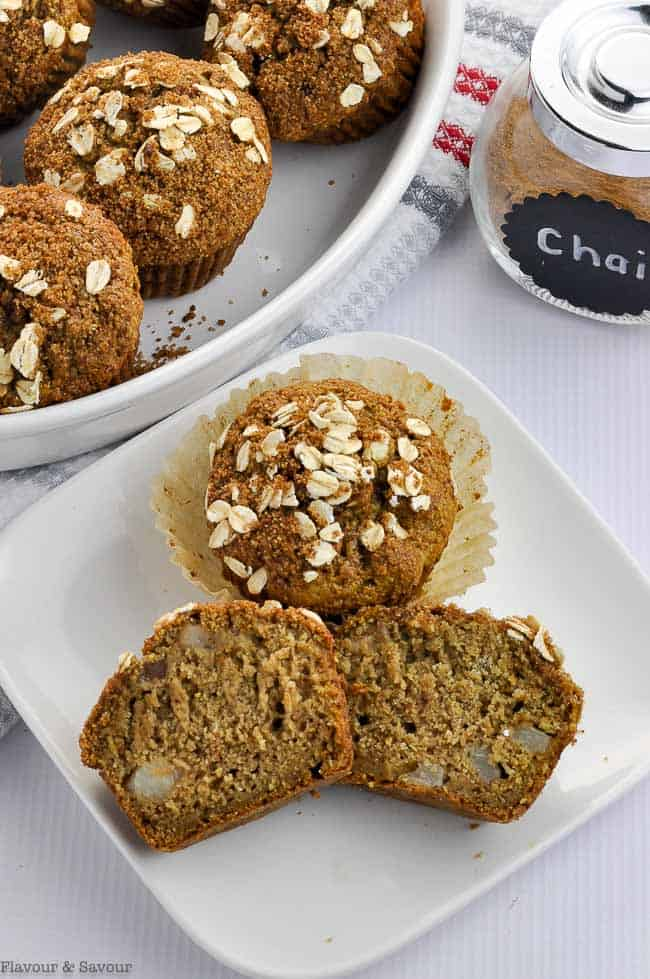 Close up view of Chai Spiced Roasted Pear Oat Muffins on a white plate
