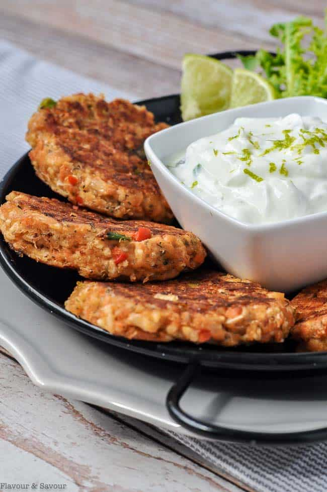 Salmon Patties with a small container of Creamy Lime and Caper dip