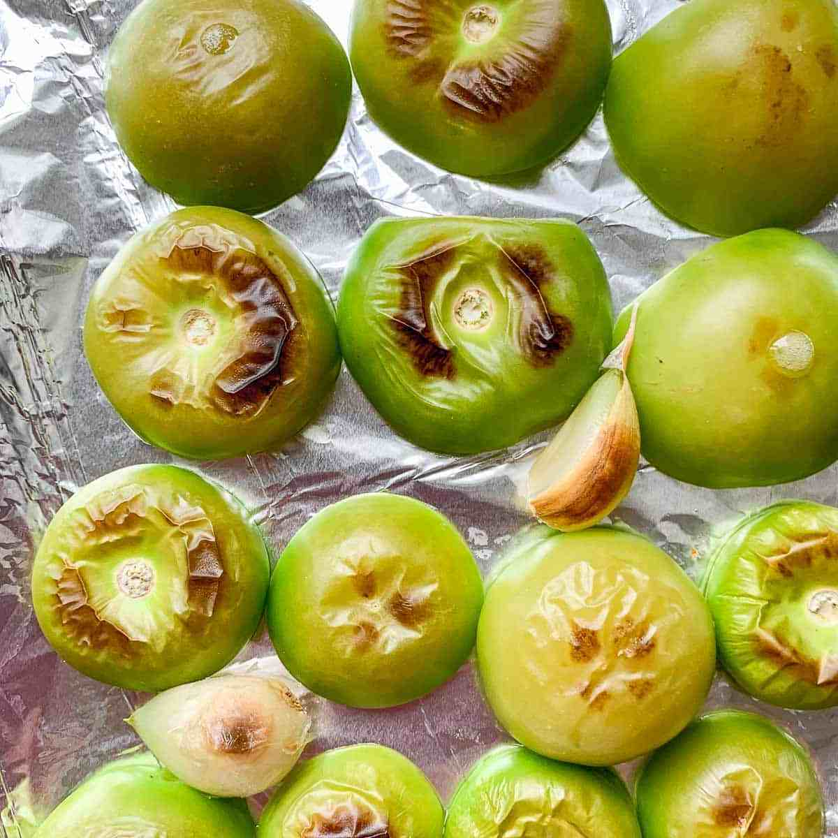 Roasted Tomatillos on a foil-lined baking sheet