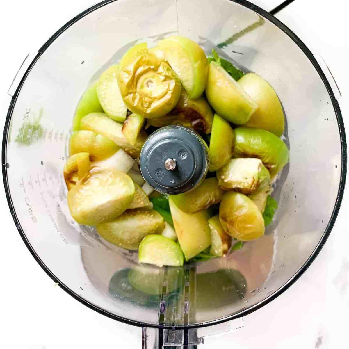 Salsa Verde ingredients in a food processor bowl