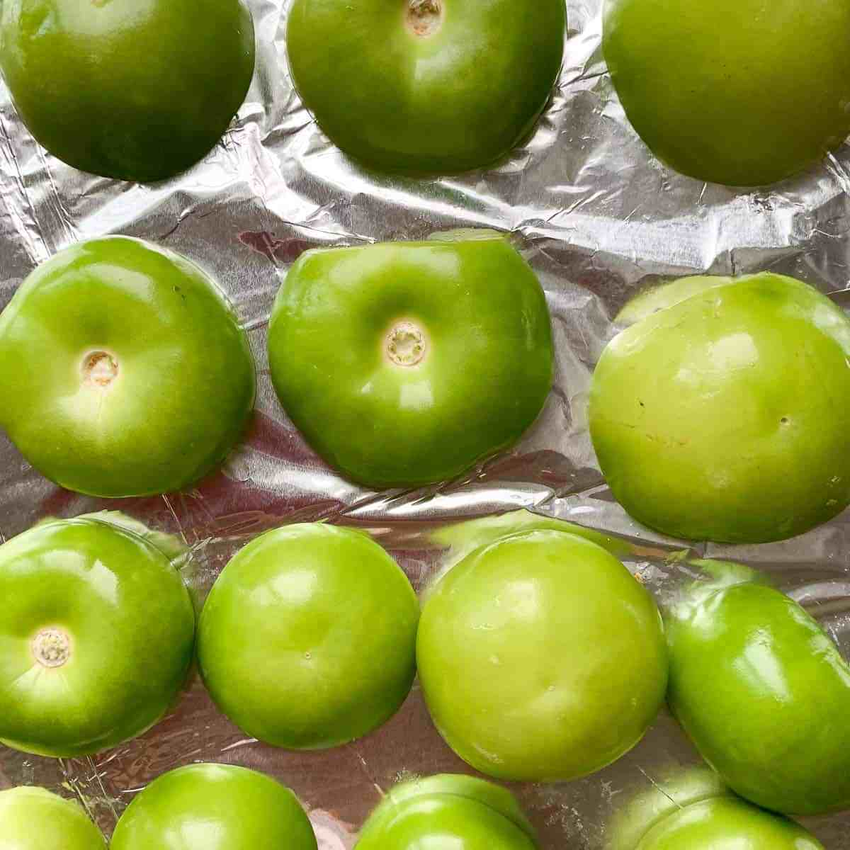 Tomatillos on a foil-lined baking sheet