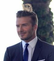 Even the most perfect man suffers a wardrobe malfunction and a bad hair day. Poor David Beckham