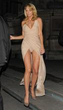 Sarah Harding suffered an awkward wardrobe malfunction when her dress flew open outside the Cosmopolitan Women of the Year Awards 2013
