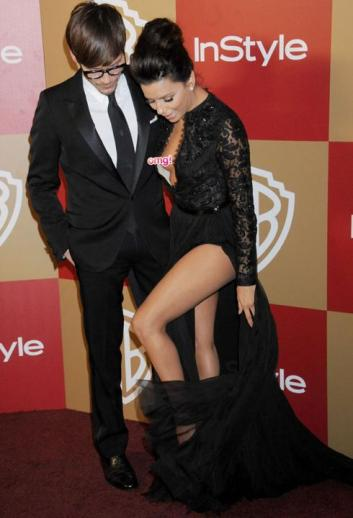 Worst Wardrobe Malfunctions- Eva Longoria fell out of her dress at the Golden Globes. Oops.