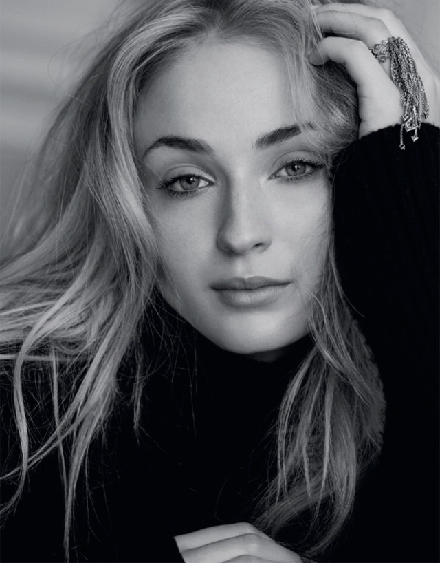 Getting her closeup, Sophie Turner wears a Louis Vuitton turtleneck sweater and ring
