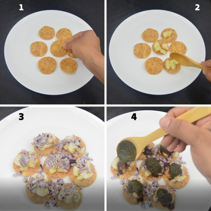 assembling papdis in white plate and topping with potato onion and green chutney