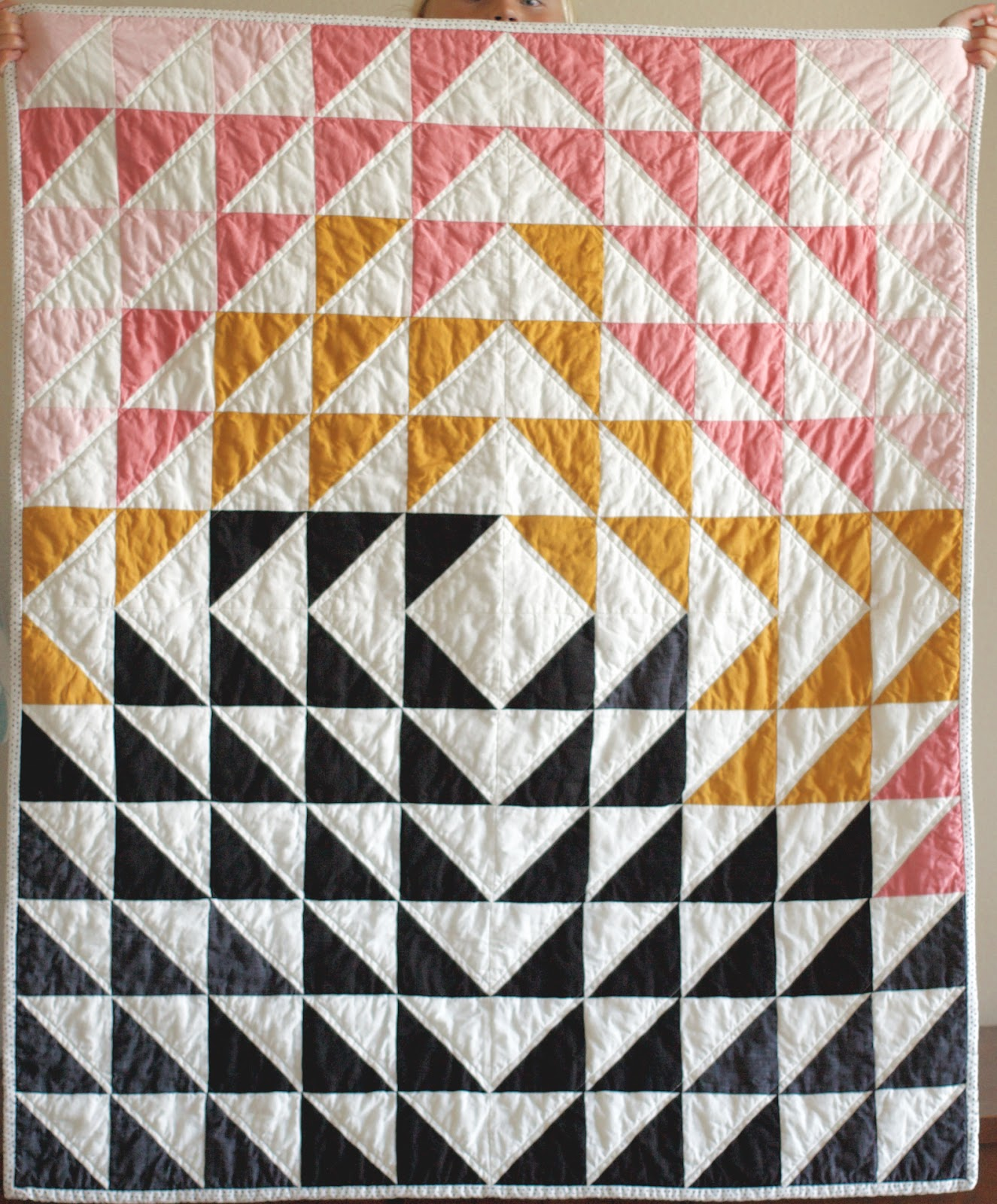 six swoonworthy modern quilts  flax  twine - i love this simple triangle quilt the flow of color designed in thisasymmetrical way is perfection you can find the quilt written about here