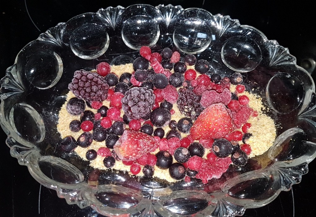 Berries on gluten-free linseed trifle dessert