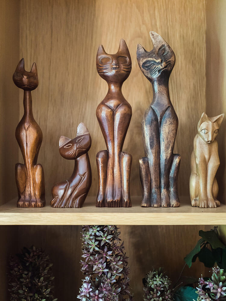 A collection of wooden cat decor that steal the show.
