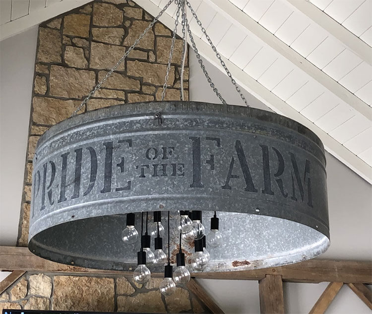A chandelier fashioned out of an iron pig trough as a part of the day in the life story.
