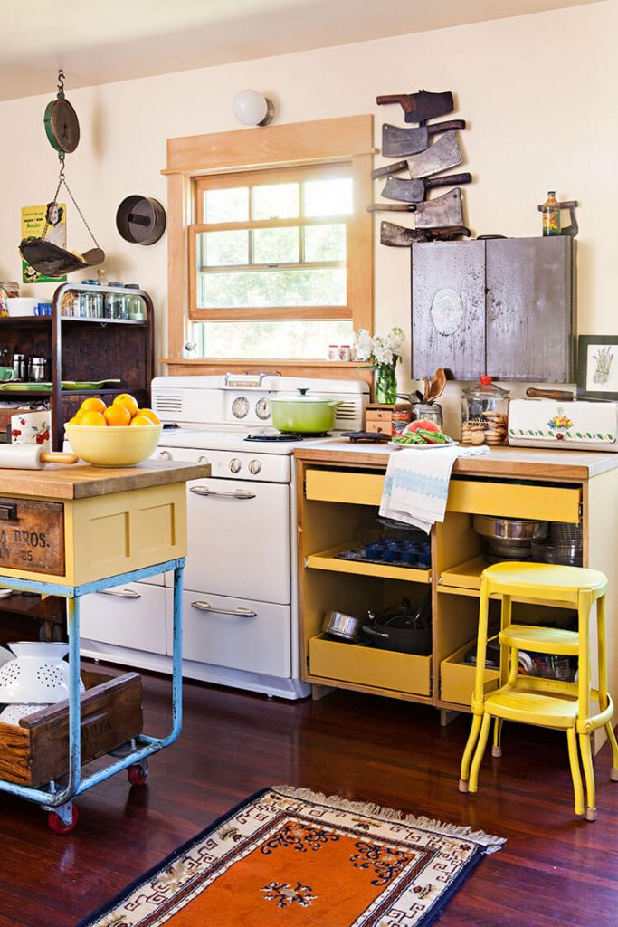 A rustic renovation showcasing a kitchen with yellow-toned furniture.