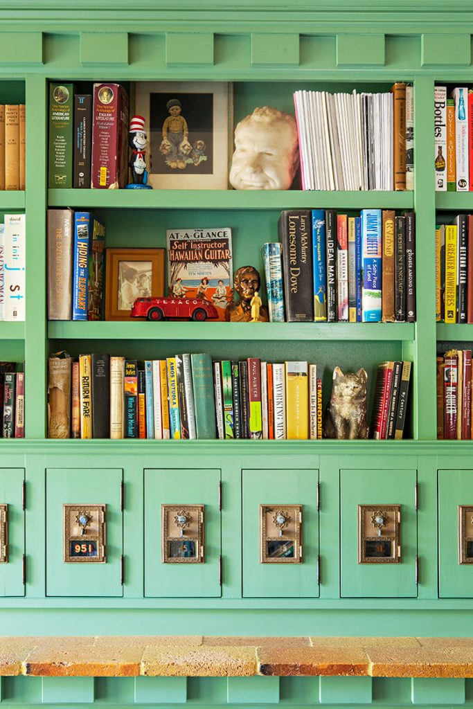 A bookshelf and toy chest painted a sea foam green color.