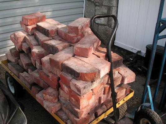 Antique bricks, given by a friend and waiting to be installed, all by Becky herself.