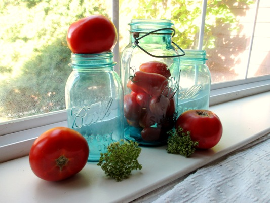 Watery aqua jars contrast with my warm red tomatoes