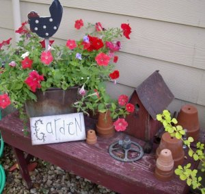 A garden bench holds some recycled treasures