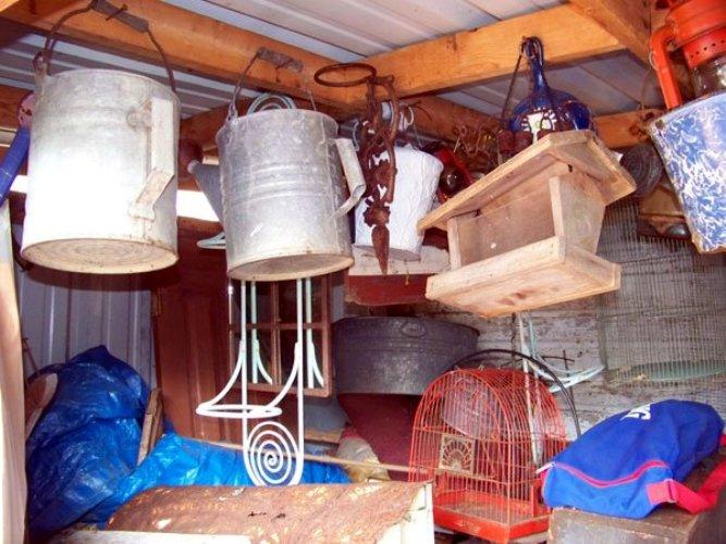 Watering cans, bird feeders, galvanized tubs, bird cages,...hmmm,...we better visit Julie...