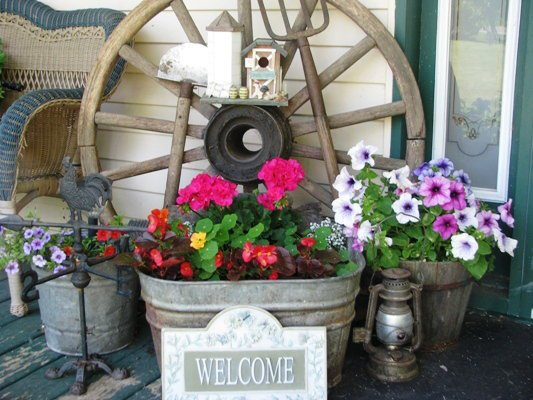 Galvanized, iron and rust,...all accented with fresh flowers