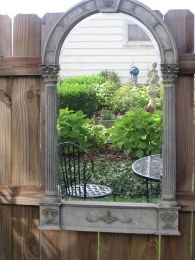Reflection in Sandy's garden mirror by Jeanie
