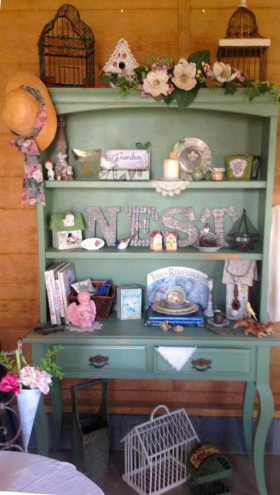 Soft sage green hutch holds Kim's small treasures