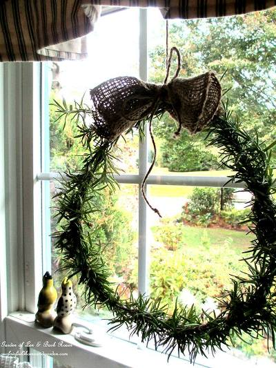 """Outside my window the garden is closed up for the winter. But I brought rosemary trimmings inside and made a fresh wreath for the kitchen window,"" says Barb Rosen, of her window."