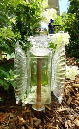 Linda Gladman's glass garden angel has a votive holder as a crown.