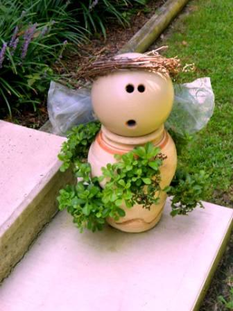 "Mary Everett says, ""Here's my garden angel, I made today. I realized the driftwood piece found on the beach was the perfect shape for wings. Found a board for the body in hubby's scrap pile, and the pots were from yard sales. I can't resist clay pots!"""
