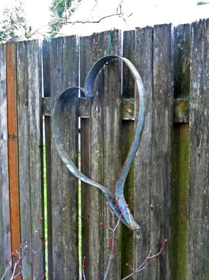 Rusty barrel hoops and spheres in the garden